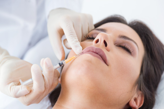 beautiful-young-woman-getting-botox-cosmetic-injection-her-face_1301-7788